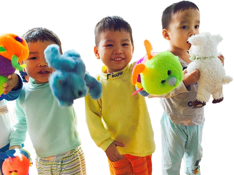 Children at an orphanage enjoy new toys