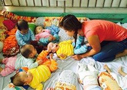 Caring for babies at an orphanage.